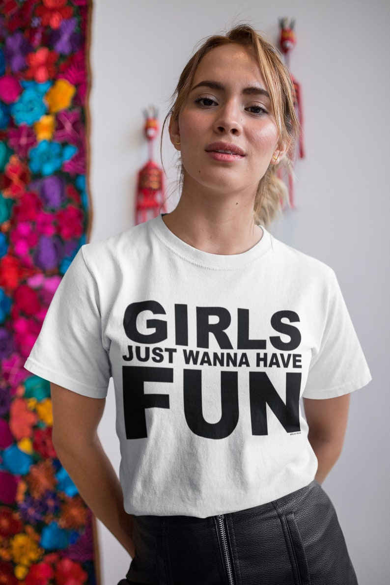 Woman wearing a Girls Just Wanna Have Fun 80s Slogan T-shirt