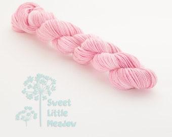 Mini skein - Beautiful hand dyed variagated pink hank of sock weight superwash merino wool