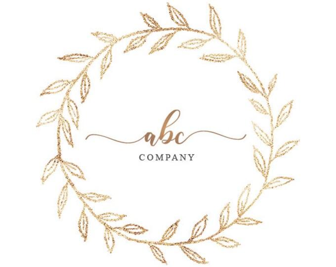 Sparkly gold wreath logo