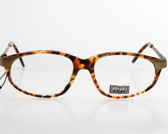c651e1d51c8 Kenzo vintage oval   cateye ladies tortoise cello eyeglasses frame.  Handmade in France in the 90s