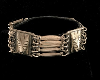 Taxco Mexican bracelet, made in 1940s, sterling silver with Aztec/Mayan faces