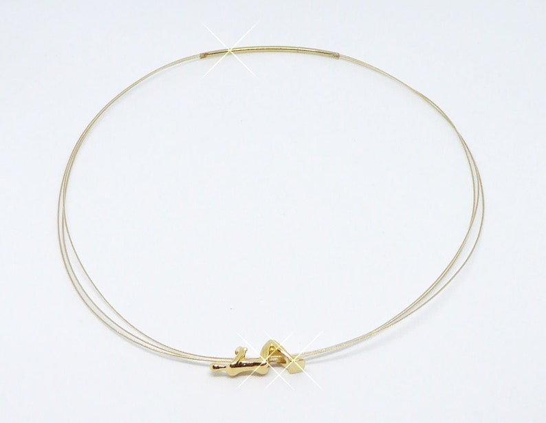 Choker 3-row gold with figurine hanging in gold necklace image 0