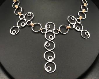 Swirls of Sterling silver rings galore