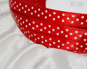 red ribbon with white polka dots in 10mm sold per metre