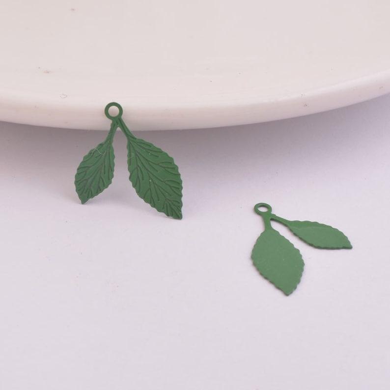 4 ivory leaf prints 20 x 11 mm metal