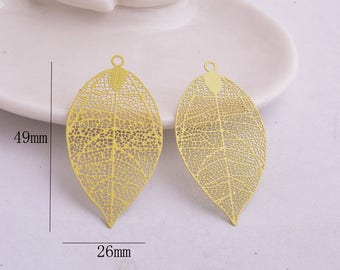 2 prints yellow leaf 49 x 26 mm metal