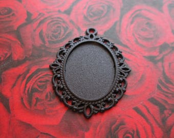 a black Medallion oval stand black cabochons 25 x 18 mm