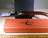Laguiole Origine Garantie vintage pocket knife with nice Leg shaped wood handle