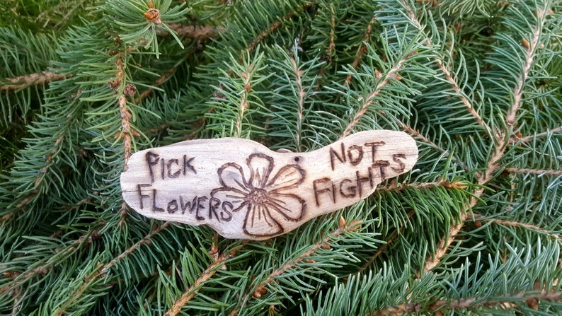 Pick Flowers Not Fights magnet