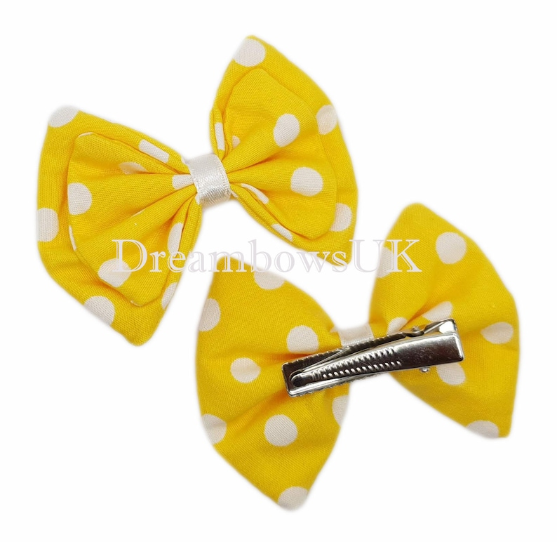 Yellow and white polka dot fabric hair bows on alligator clips image 0