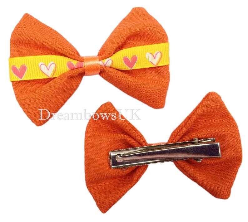 Orange fabric heart design hair bows on alligator clips image 0
