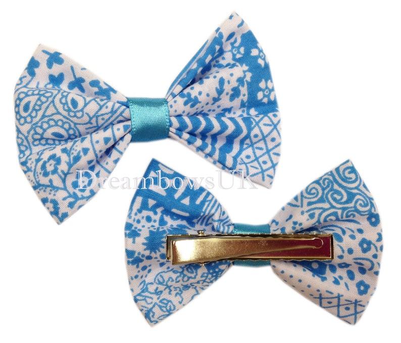 Turquoise and white novelty fabric hair bows on alligator image 0