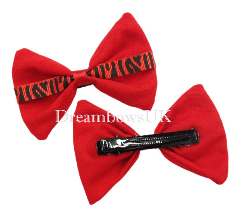 Red and black animal print hair bows on alligator clips girls image 0