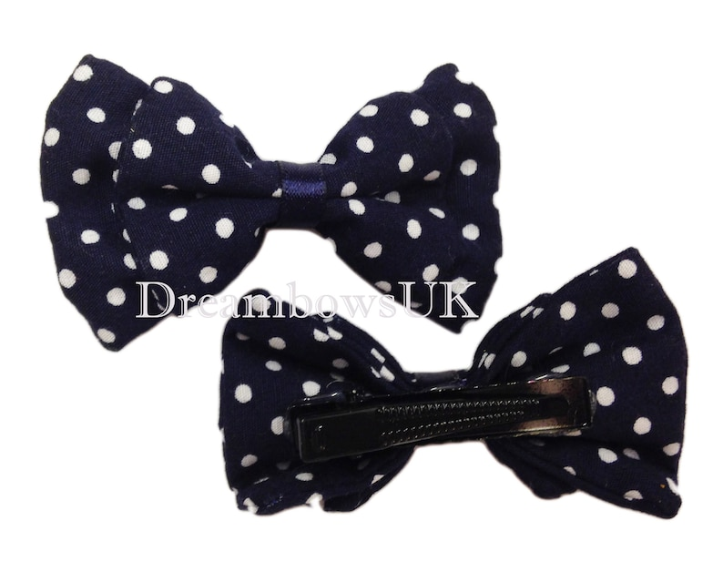 Navy blue and white polka dot fabric hair bows on alligator image 0