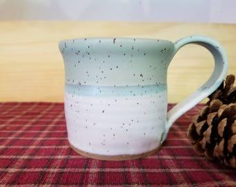 Icy turquoise and white pottery mug