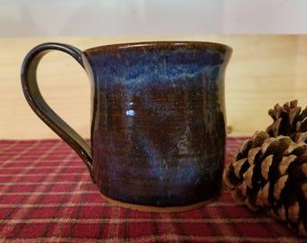 Floating  blue pottery mug