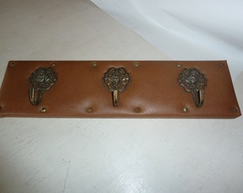 Coat rack, leather with copper