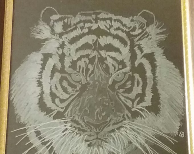 Tiger face engraved in glass