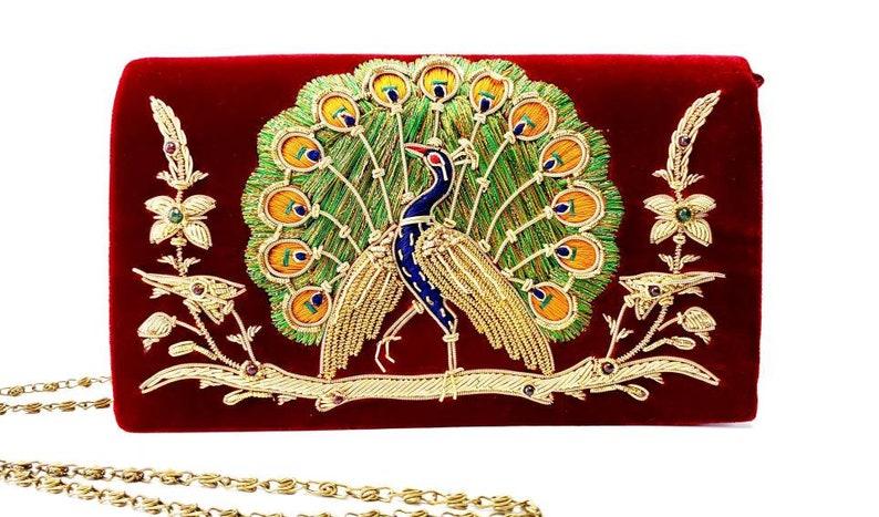 Embroidered peacock burgundy velvet evening bag Zardozi gold image 0