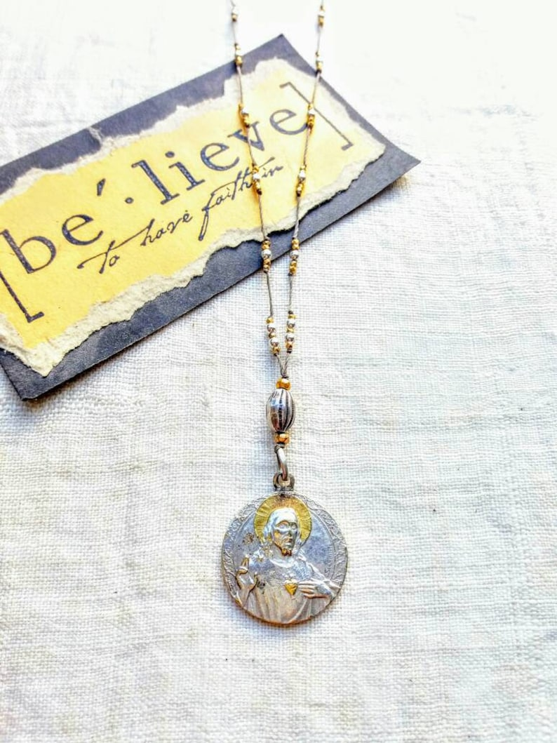 Antique silver and gold  sacred heart necklace .