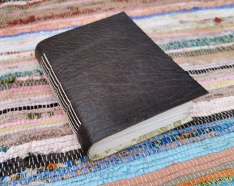 A6 dark taupe leather watercolour journal. Hand bound and one of a kind.