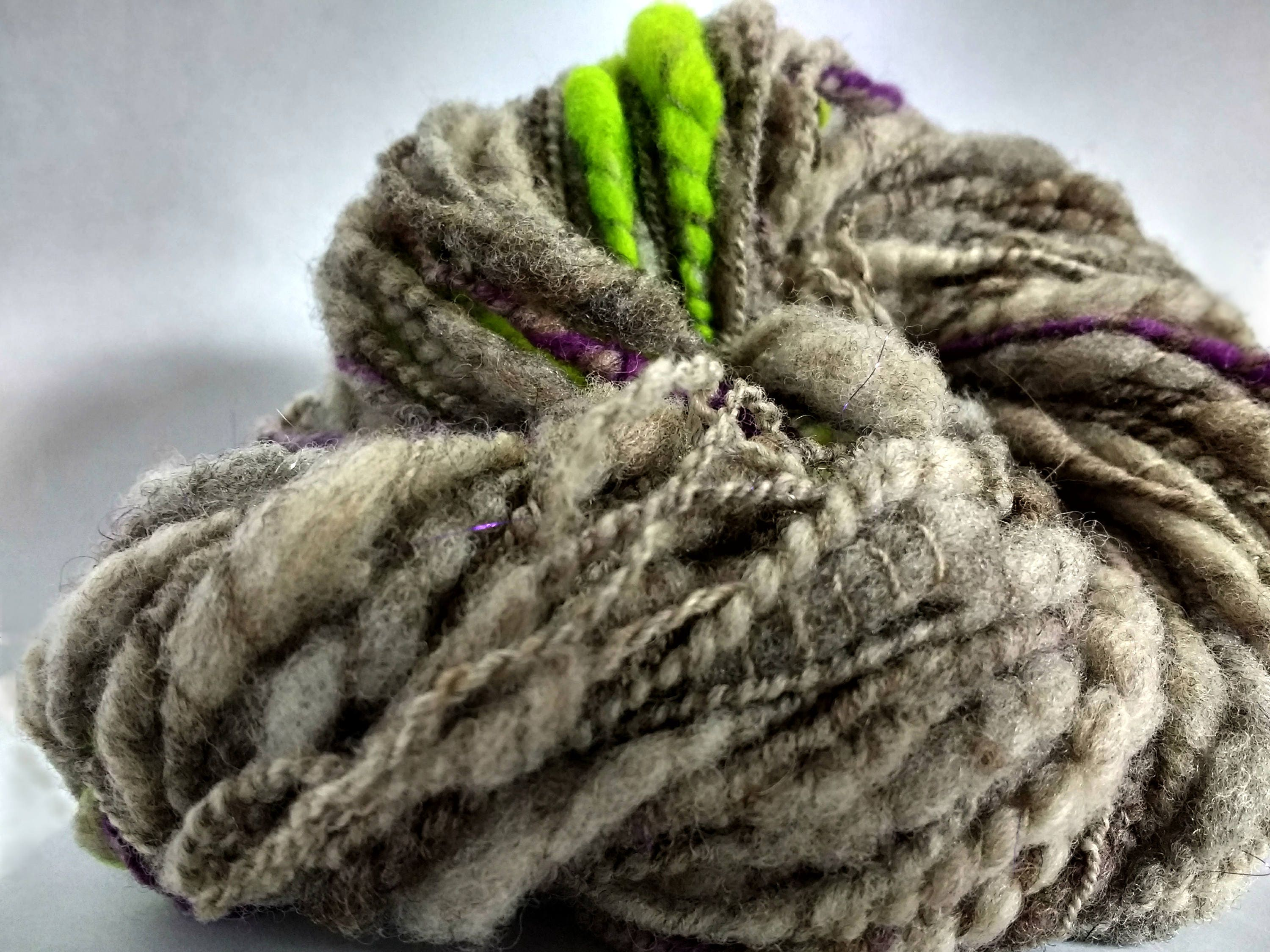 Thick and thin yarn w purple green wool slubs, slub art yarn, undyed ...