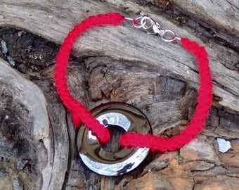 Red bracelet with hematite stone