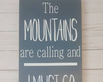 The Mountains are calling and I must go- deep blue wood sign