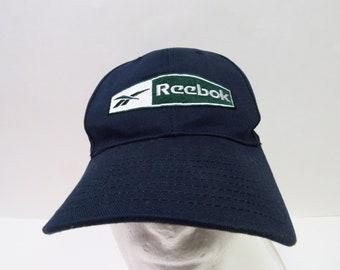 bf9d13a2ed5 Vintage 90 s Reebok Athletics Navy Baseball Hat OSFM
