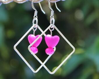 Diamond shape dangle earrings with pink heart