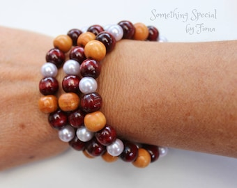 Wood beaded bracelet with pale purple feature beads, made on memory wire