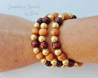 Wood beaded bracelet with gold glass pearl feature beads, made on memory wire
