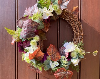 Artificial floral front door wreath for summer and autumn, with foliage and flowers