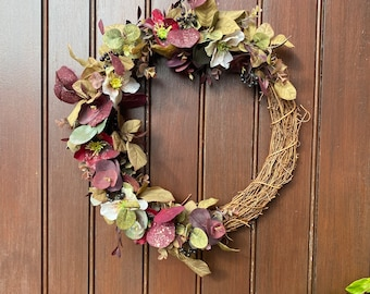 Autumn front door wreath with aubergine purple and gold artificial flowers and foliage