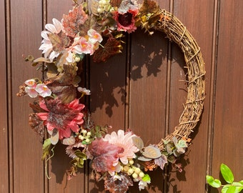 Pink gerberas and autumn leaves autumnal front door wreath, decorated with artificial flowers for year round use