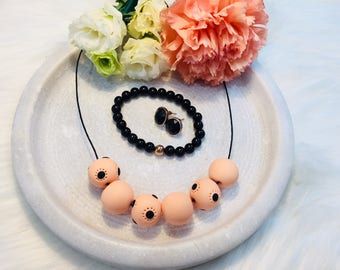 Peach and black spotted polymer clay necklace