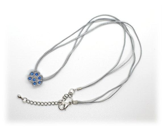 Necklace with rhinestone dog paw