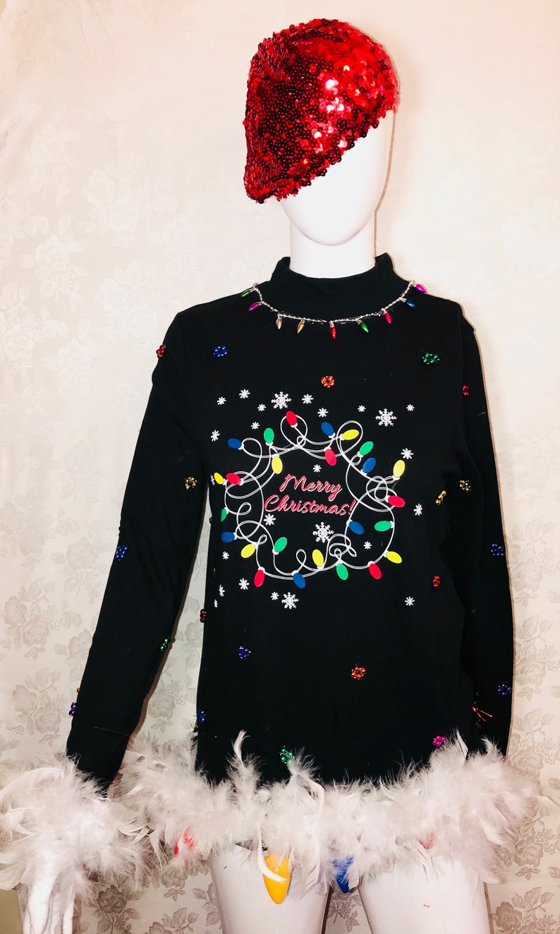 Best Ugly Christmas Sweater.Best Ugly Christmas Sweater Merry Christmas With Lights Theme With White Boas And Large Lights At Bottom Of Sweater