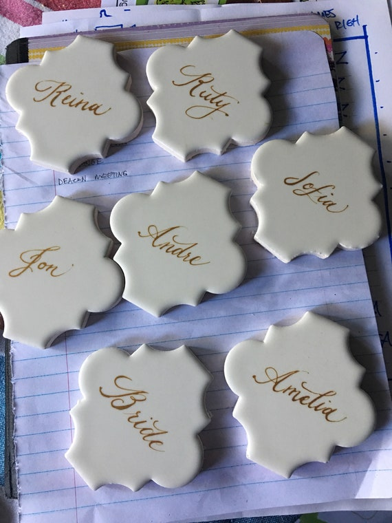 Ceramic wedding place cards personalized with custom calligrpahy