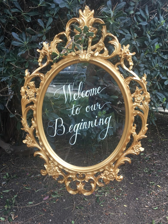 Gold decorative wedding sign with glass