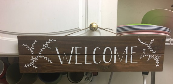 Hand drawn wood welcome sign with floral vine