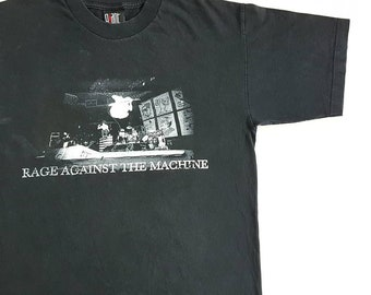 91d8eb6d794f93 Vintage 1999 Rage Against The Machine Flying Tom T Shirt size L (W 21.5 x L  29)