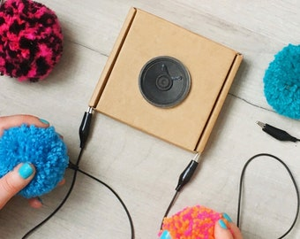 DIY Pompom Musical Instrument Kit: craft with e-textiles to make an electronic musical instrument, played by squeezing pompoms!