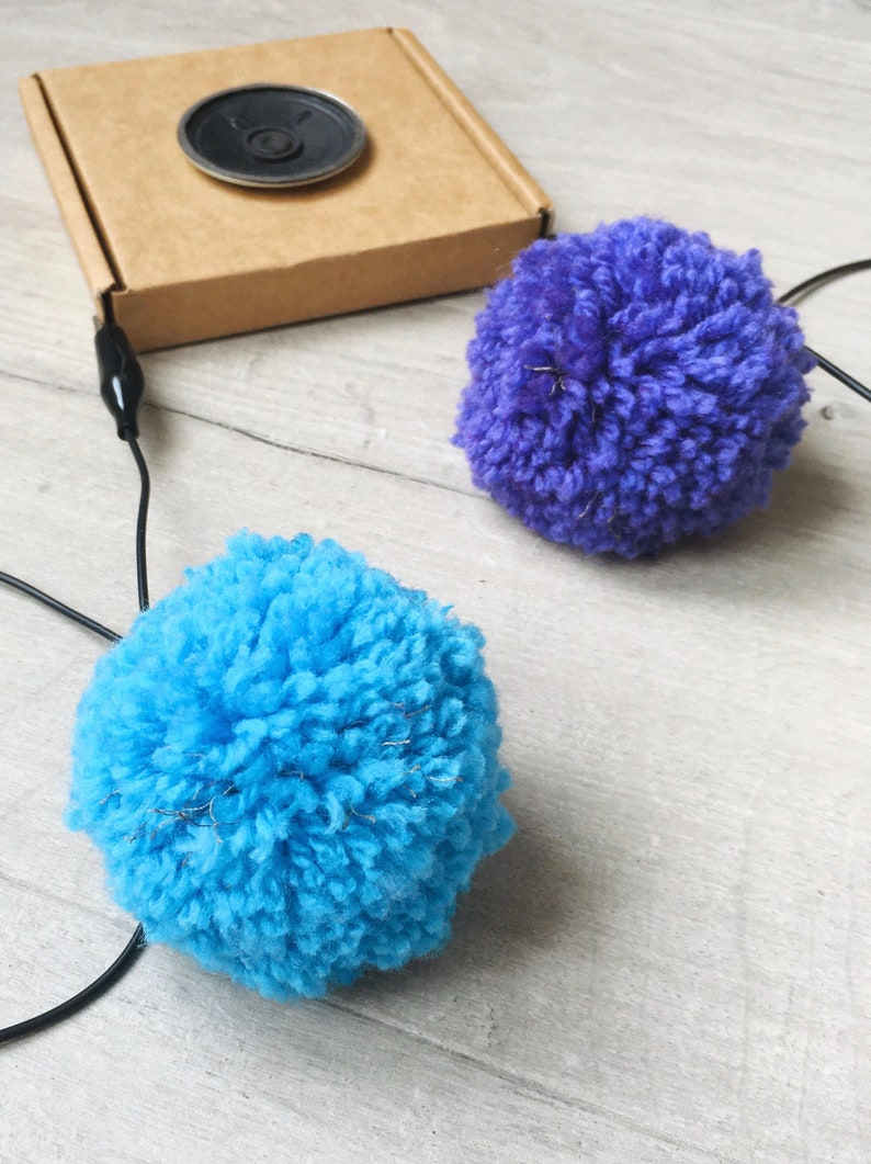 played by squeezing pompoms! DIY Pompom Musical Instrument Kit craft with e-textiles to make an electronic musical instrument