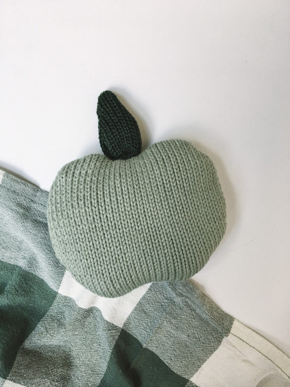 Knitted apple for dinette or merchant game