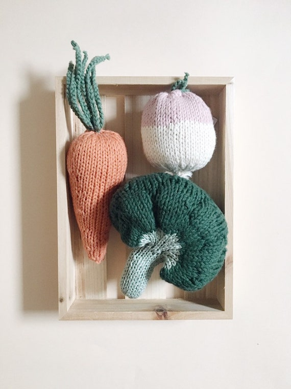 The basket of vegetables for soup contains a turnip, carrot, broccoli, dinette knit market game