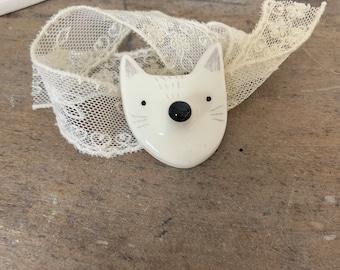 White ceramic snow fox brooch