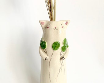 Cat with green leaves soliflore in ceramic enamelled vase