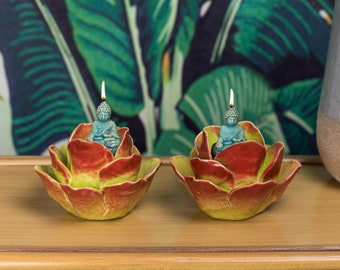 2-Piece porcelain finish Lotus Flower Candle Holder with Witness Buddha. Vibrant colors of orange, green and yellow.