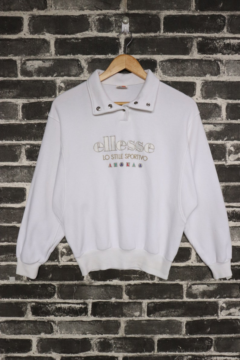 8187db0a3d9c1 Vintage Ellesse Sweater 90s Pull over Offwhite Embroidery Glittery logo  Warming up wear/sport wear/fashion Ladies legging High Top Size M